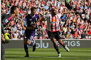 Sunderland Defender Younes Kaboul and Tottenham Hotspur defender Eric Dier battle at a corner during the Barclays Premier League match between Sunderland and Tottenham Hotspur at the Stadium Of Light, Sunderland, England on 13 September 2015. Photo by Simon Davies.