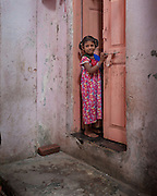 Young Girl in Doorway, Dharavi, Mumba, India