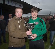 Dundee Summer League treasurer Stephen Pettigrew  presents the George McArthur memorial cup to FC Kettledrum captain Cammy Johnstone - FC Kettledrum (blue) v Hawkhill Athletic (red), George McArthur memorial cup final at Glenesk.<br /> <br />  - &copy; David Young - www.davidyoungphoto.co.uk - email: davidyoungphoto@gmail.com
