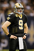 NEW ORLEANS, LA - DECEMBER 26:   Drew Brees #9 of the New Orleans Saints waits on the field for a play to be called during a game against the Atlanta Falcons at Mercedes-Benz Superdome on December 26, 2011 in New Orleans, Louisiana.  The Saints defeated the Falcons 45-16.  (Photo by Wesley Hitt/Getty Images) *** Local Caption *** Drew Brees
