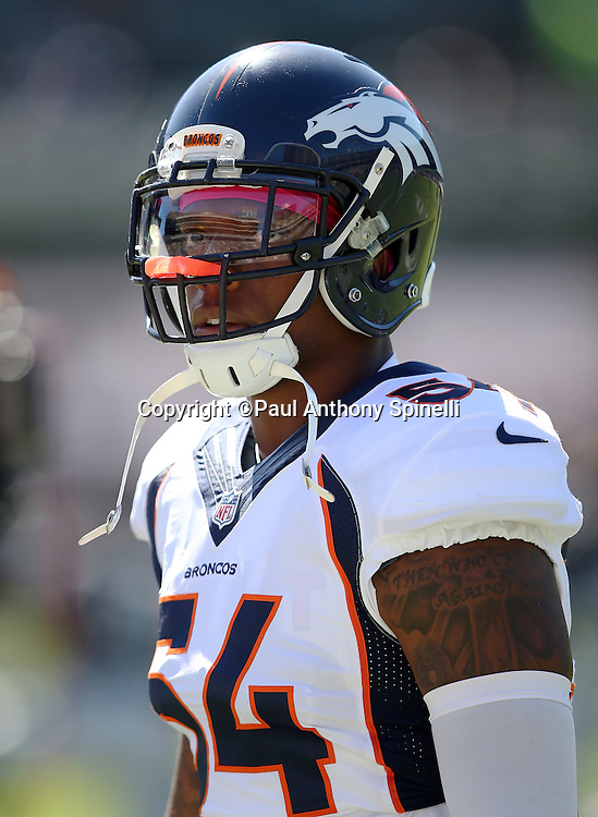 Denver Broncos inside linebacker Brandon Marshall (54) looks on from the sideline during the 2015 NFL week 5 regular season football game against the Oakland Raiders on Sunday, Oct. 11, 2015 in Oakland, Calif. The Broncos won the game 16-10. (©Paul Anthony Spinelli)