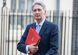 © Licensed to London News Pictures. 18/11/2014. Westminster, UK. Foreign Secretary Philip Hammond leaves the Cabinet and COBRA meetings.  Ministers and MP's on Downing Street 18th November 2014. Photo credit : Stephen Simpson/LNP