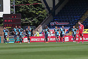 Wycombe celebrate as a Disconsolate Keith Lowe looks on after gifting Wycombe their opening goal during the Sky Bet League 2 match between Wycombe Wanderers and York City at Adams Park, High Wycombe, England on 8 August 2015. Photo by Simon Davies.