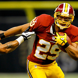 September 9, 2012; New Orleans, LA, USA; Washington Redskins running back Roy Helu (29) breaks away from New Orleans Saints linebacker Jonathan Casillas (52) during the first quarter of a game at the Mercedes-Benz Superdome. Mandatory Credit: Derick E. Hingle-US PRESSWIRE
