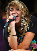 Sierra Kusterbeck, lead vocalist for the Band Versa Emerge, entertains the crowd at the Vans Warped Tour in Atlanta, Georgia