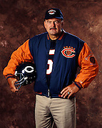 Former Chicago Bears linebacker and member of the Pro Football Hall of Fame Dick Butkus poses for a photograph wearing an NFL Chicago Bears Throwbacks jacket and hat while holding a Bears throwbacks helmet July 8, 1993 in Los Angeles. (©Paul Anthony Spinelli)