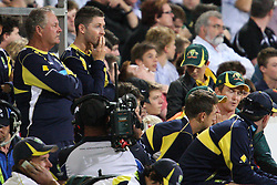 © Licensed to London News Pictures. 08/03/2012. Adelaide Oval, Australia. Injured Australian captain Micheal Clarke (centre) puts his hand on his mouth as he anxiously watches the close match coming to an end during the One Day International cricket match final between Australia Vs Sri Lanka. Photo credit : Asanka Brendon Ratnayake/LNP