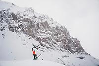 Jacki Arévalo gets ready for the down in the alpine terrain above the Mount Hayden Backcountry Lodge, San Juan Range, Colorado.