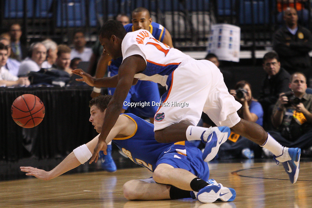 Mar 17, 2011; Tampa, FL, USA; UC Santa Barbara Gauchos forward Jon Pastorek (32) and Florida Gators guard Erving Walker (11) scramble for a loose ball during first half of the second round of the 2011 NCAA men's basketball tournament at the St. Pete Times Forum.  Mandatory Credit: Derick E. Hingle