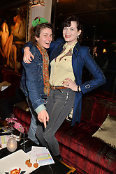 Left to right, POPPY LLOYD and JASMINE GUINNESS at the Pig Pledge Evening at Club no41, 41 Conduit Street, London on 10th March 2014.