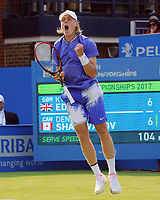 Tennis - 2017 Aegon Championships [Queen's Club Championship] - Day One, Monday<br /> <br /> Men's Singles, Round of 32<br /> Kyle Edmund [GBR] vs. Denis Shapovalov [Canada]<br /> <br /> Denis Shapovalov celebrates winning the first set on a tie break, on Centre Court.<br /> <br /> COLORSPORT/ANDREW COWIE