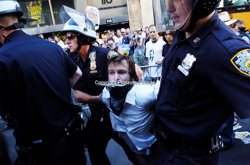 Dermonstrators are arrested after a paper dragon was set on fire by anarchist on Seventh Avenue near Madison Square Garden August 29, 2004 in New York City. Several arrest were made as thousands of protestors marched in front of the site of the upcoming Republican National Convention.