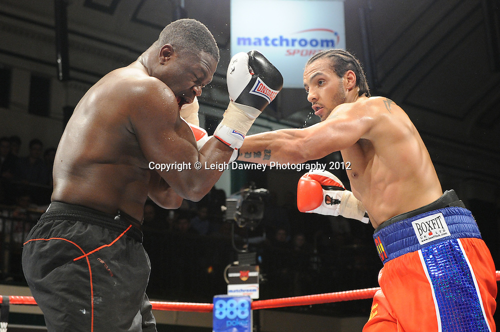 Wadi Camacho (red/blue shorts) defeats  Moses Matovu  in a 4x3min Cruiserweight contest at York Hall, Bethnal Green, London on 28th January 2012.Matchroom Sport. © Leigh Dawney Photography 2012.