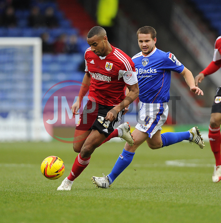 Bristol City's Tyrone Barnett battles for the ball with Oldham Athletic's James Wesolowski - Photo mandatory by-line: Joe Meredith/JMP - Tel: Mobile: 07966 386802 08/02/2014 - SPORT - FOOTBALL - Oldham - Boundary Park - Oldham Athletic v Bristol City - Sky Bet League One