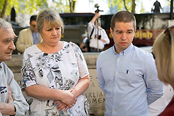 """© Licensed to London News Pictures. 08/05/2018. London, UK. Sam Hallam (right) arriving at the Supreme Court with his mother Wendy Cohen, where he is appealing for """"miscarriage of justice"""" compensation. Hallam spent over seven years in jail after he was wrongly sentenced to life in 2005 for a gang-related murder in north London that he did not commit. Photo credit : Tom Nicholson/LNP"""