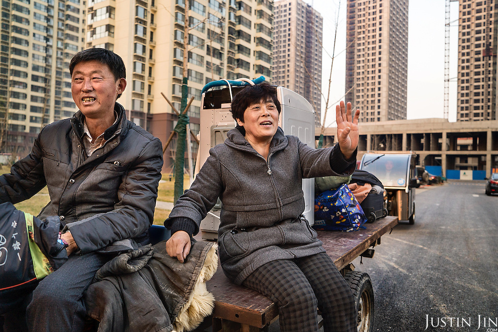 A couple, who were farmers until their farms were destroyed by the government two years ago, returns to the place where their village once stood. They will move into one of the apartments, dubbed &quot;replacement home&quot;. <br /> <br /> China is pushing ahead with a dramatic, history-making plan to move 100 million rural residents into towns and cities over six years &mdash; but without a clear idea of how to pay for the gargantuan undertaking or whether the farmers involved want to move.<br />
