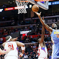 24 February 2016: Denver Nuggets forward Kenneth Faried (35) goes for the layup past Los Angeles Clippers forward Luc Richard Mbah a Moute (12) during the Denver Nuggets 87-81 victory over the Los Angeles Clippers, at the Staples Center, Los Angeles, California, USA.