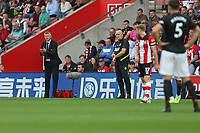 Football - 2019 / 2020 Premier League - Southampton vs. Manchester United<br /> <br /> Manchester United Manager Ole Gunnar Solskjaer applauds his side as his Assistant Manager Mike Phelan question the time taken during the Premier League match at St Mary's Stadium Southampton <br /> <br /> COLORSPORT/SHAUN BOGGUST