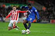 Romelu Lukaku of Everton is challenged by Stoke city's Geoff Cameron.  Barclays Premier League match, Stoke city v Everton at the Britannia Stadium in Stoke on Trent , Staffs on Wed 4th March 2015.<br /> pic by Andrew Orchard, Andrew Orchard sports photography.