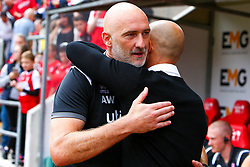 Former Rotherham United player and current Lincoln City goalkeeping coach Andy Warrington shares a hug with former teammate and current Rotherham United manager Paul Warne - Mandatory by-line: Ryan Crockett/JMP - 10/08/2019 - FOOTBALL - Aesseal New York Stadium - Rotherham, England - Rotherham United v Lincoln City - Sky Bet League One