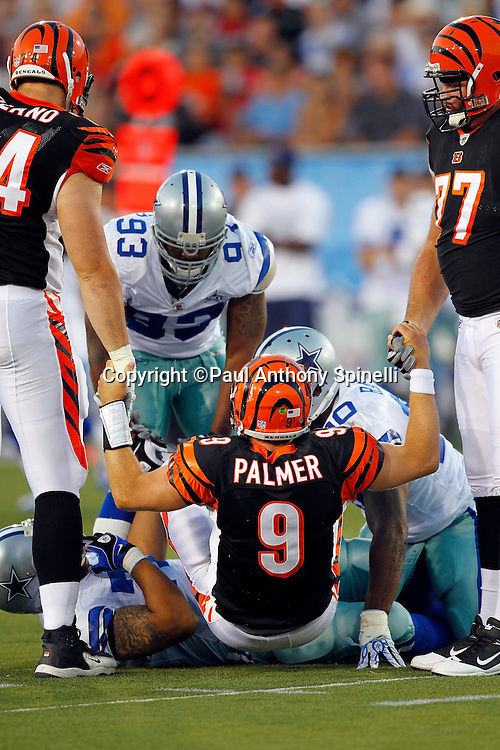 Cincinnati Bengals quarterback Carson Palmer (9) gets a lift from teammates during the NFL Pro Football Hall of Fame preseason football game between the Dallas Cowboys and the Cincinnati Bengals on Sunday, August 8, 2010 in Canton, Ohio. The Cowboys won the game 16-7. (©Paul Anthony Spinelli)