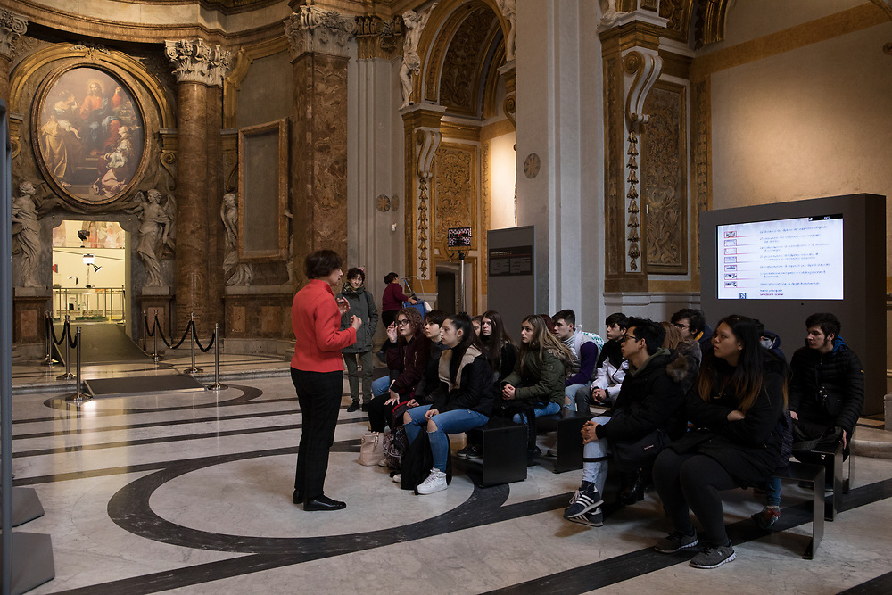 Rome, Italy, March 15th, 2018. The open restoration site was set up by the Istuituto Superiore per la Conservazione ed il Restauro of Rome inside the former church of Santa Marta al Collegio Romano. Laura D'Agostino, Art historian introduces to the students from a second year class from the Liceo Artistico di Via Sarandì of Rome the different process of restoration taking place in the site. The project was conceived to give the public the possibility of participating in the life of a restoration site and increase the awareness of  non-specialist visitors  of the importance of conservation in our artistic heritage. Opened in 2017, the site will be active for the whole 2018.<br /> 