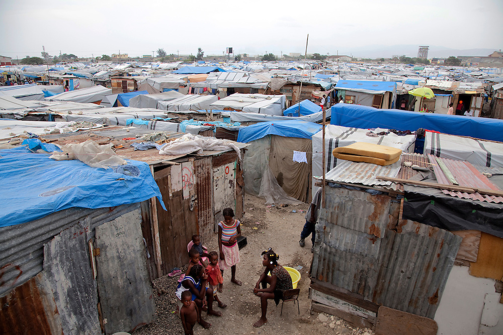 An overview of the makeshift refugee camp, La Piste, in Port-au-Prince, Haiti on July 15, 2010. <br /> <br /> La Piste (French for &quot;runway&quot;)is a settlement sprawled across the site of a disused airport and now home to an estimated 20,000 earthquake survivors living in makeshift structures.<br /> <br /> Six month after a catastrophic earthquake measuring 7.3 on the Richter scale hit Haiti on January 13, 2010, killing an estimated 230,000 people, injuring an estimated 300,000 and making homeless an estimated 1,000,000.