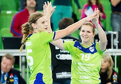 Barbara Lazovic-Varlec #15 of RK Krim Mercator and Neli Irman of Krim Mercator celebrate during handball match between RK Krim Mercator (SLO) and HC Leipzig (GER) in 6th Round of Women's Champions League on November 16, 2013 in Arena Stozice, Ljubljana, Slovenia.  Photo by Vid Ponikvar / Sportida