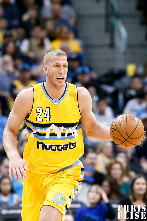 04 March 2017: Denver Nuggets center Mason Plumlee (24) brings the ball up court during the Charlotte Hornets 112-102 victory over the Denver Nuggets, at the Pepsi Center, Denver, Colorado, USA.