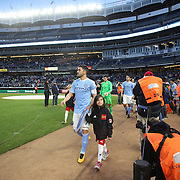 David Villa, NYCFC, heads onto the pitch with the teams before the start of  the New York City FC Vs Orlando City, MSL regular season football match at Yankee Stadium, The Bronx, New York,  USA. 18th March 2016. Photo Tim Clayton