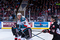 KELOWNA, CANADA - MARCH 14:  Carsen Twarynski #18 of the Kelowna Rockets keeps his eye on an airborne puck against the Prince George Cougars on March 14, 2018 at Prospera Place in Kelowna, British Columbia, Canada.  (Photo by Marissa Baecker/Shoot the Breeze)  *** Local Caption ***