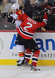 Feb 11; Newark, NJ, USA; New Jersey Devils defenseman Kurtis Foster (2) hits Florida Panthers center Marcel Goc (57) during the third period at the Prudential Center. The Panthers defeated the Devils 3-1.