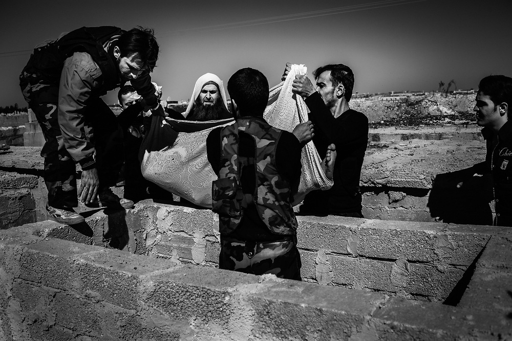 Aleppo, Syria, 2012/10/18.<br /> The corpse of a FSA fighter is buried at the cemetery by his katiba comrades.
