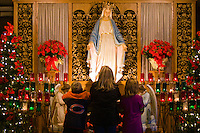 "CHAMPION, WI - DECEMBER 22: Visitors pray to the Blessed Virgin Mary in the site that is said to be the spot where Sister Adele Brise was visited on three occasions from the Blessed Virgin Mary in 1859 at the Shrine of Our Lady of Good Help, December 22, 2010 in Champion, Wisconsin. After years of research, the Bishop of Green Bay determined that the sightings of Mary ""clothed in dazzling white"" are indeed ""worthy of belief"" and now have now been officially sanctioned as real by the Vatican. This shrine is the first of such for the United States and now joins the company of Lourdes and Fatima.   (Darren Hauck )"