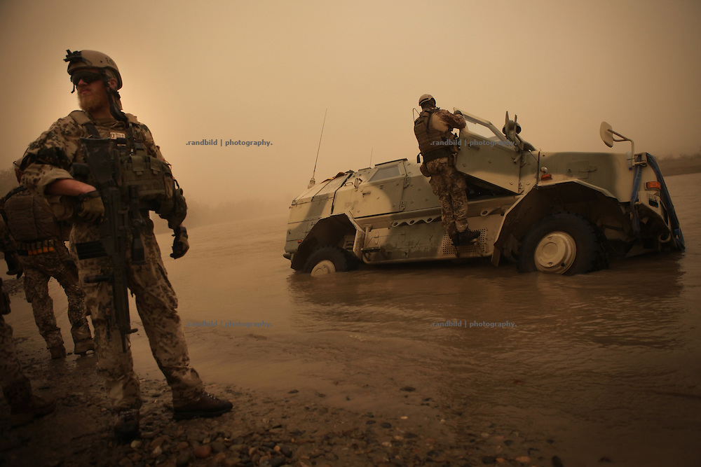 An armored Dingo vehicle of the ECHO patoon sunk and stuck after the driver accidentially lost the way through a ford in the Konduz river near Rahmat Bay. After comrades supports the passengers by getting out of the truck they rescued it. In late October 2011 Kunduz based 3.Task Force started a several days operation in and around Nawabad (District Chahar Darah), west of Kunduz, northern Afghanistan. During the Operation Orpheus about 100 german infantery soldiers rolled out for patrols through the town and surrounding areas, which were expected as a retreat zone of insurgents.