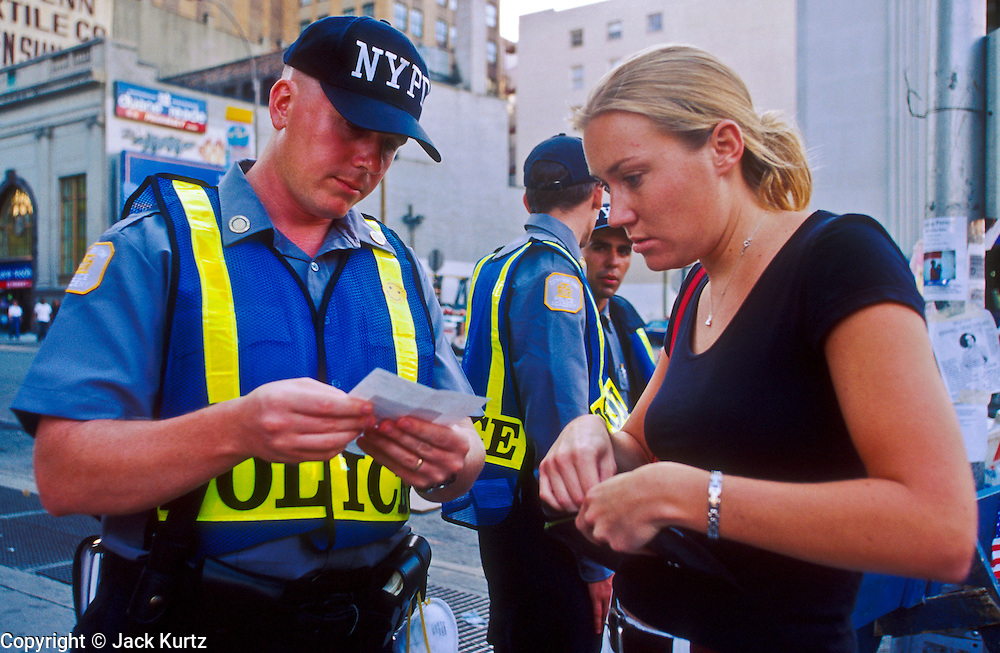 NEW YORK, NY: New York city police cadets check the identification of people trying to go below Canal Street towards the World Trade Center, Sept 19, 2001. NY police shut down lower Manhattan after terrorists crashed two hijacked jetliners into the WTC towers on Sept 11, 2001, killing almost 3,000 people.  PHOTO BY JACK KURTZ