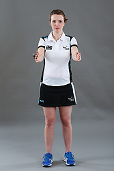 Umpire Louise Travis signalling obstruction of player with ball