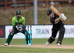 New Zealand's Kane Williamson, right, plays a shot in front of Pakistan's Sarfraz Ahmed in the third one day cricket international at the University of Otago Oval, Dunedin, New Zealand, Saturday, January 13, 2018. Credit:SNPA / Adam Binns ** NO ARCHIVING**