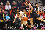 Mississippi Lady Rebels guard Erika Sisk (5) is fouled by Tennessee Martin Skyhawks forward Chelsea Roberts (14) in a WNIT game in Oxford Miss. on Wednesday, March 18, 2015. 9 (AP Photo/Oxford Eagle, Bruce Newman)