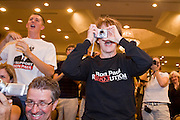 """May 22, 2008 - Phoenix, AZ: A woman photographs Ron Paul at a rally in Phoenix Thursday. About 850 people crowded into the ballroom at the Pointe Hilton Squaw Peak Resort in Phoenix, AZ, to hear Republican presidential hopeful Ron Paul speak. Although Arizona Sen. John McCain is the """"presumptive"""" Republican candidate for president, Texas Congressman Ron Paul is staying in the race and actively campaigning for the Presidency. Photo by Jack Kurtz"""