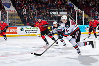 KELOWNA, BC - DECEMBER 30:  Josh Maser #11 of the Prince George Cougars checks Jadon Joseph #18 as Dillon Hamaliuk #22 of the Kelowna Rockets moves the puck up the ice during first period at Prospera Place on December 30, 2019 in Kelowna, Canada. (Photo by Marissa Baecker/Shoot the Breeze)