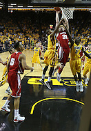 January 19 2013: Wisconsin Badgers forward Mike Bruesewitz (31) puts up a shot between Iowa Hawkeyes forward Melsahn Basabe (1) and guard Anthony Clemmons (5) during the first half of the NCAA basketball game between the Wisconsin Badgers and the Iowa Hawkeyes at Carver-Hawkeye Arena in Iowa City, Iowa on Sautrday January 19 2013. Iowa defeated Wisconsin 70-66.