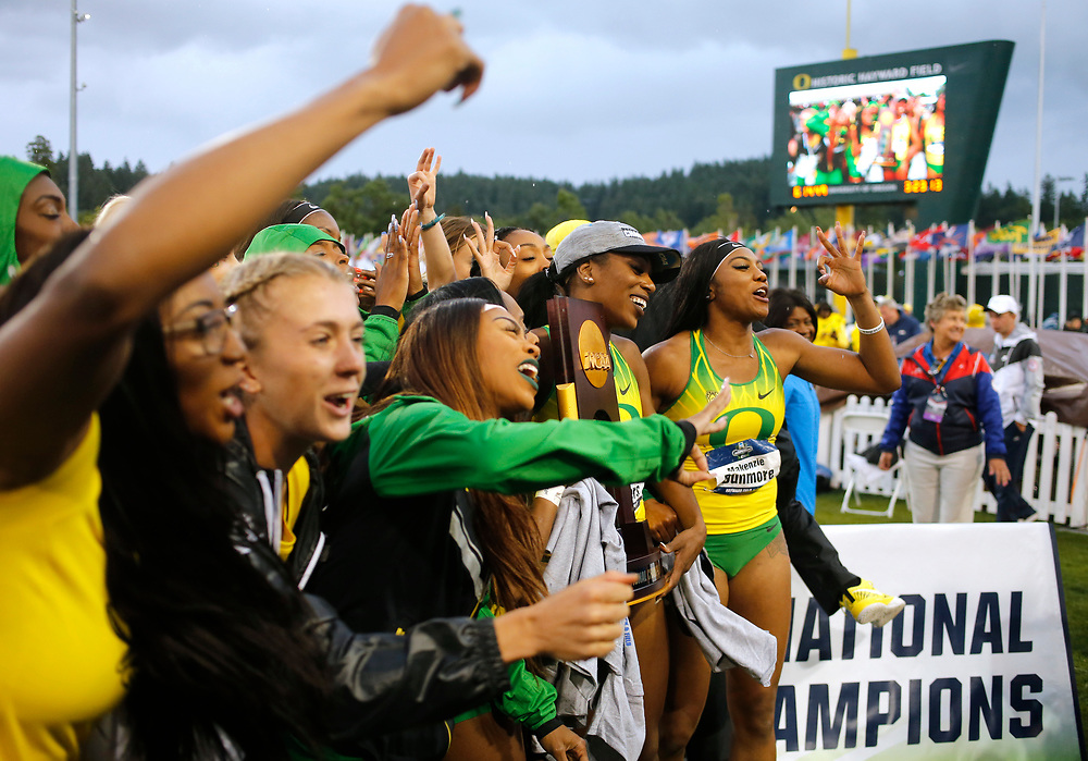 The University of Oregon women's track team celebrate their team championships on the final day of the NCAA outdoor college track and field championships in Eugene, Ore., Saturday, June 10, 2017. (AP Photo/Timothy J. Gonzalez)