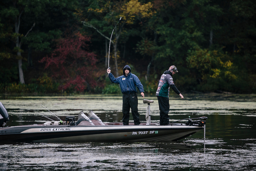 Billy Hines, left and Kyle Brown, right, of Slippery Rock University, fish for bass during the FLW College Fishing Northern Conference Invitational in Marbury, MD on Oct. 11, 2014. Only the top 15 of 43 teams moved on to Sunday.