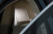 Image of a 2010 Porsche Panamera embossed logo on the headrest, California, America west coast