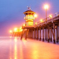 Huntington Beach Pier sunrise panorama photo in Orange County Southern California. Panoramic photo ratio is 1:3.