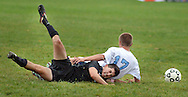 TOWAMENCIN, PA - OCTOBER 7: Central Bucks West's Nick DiPietro #25 crashes to the ground along with North Penn's Colin Jerome #17as they chase a loose ball in the first half at North Penn high school October 7, 2014 in Towamencin, Pennsylvania. (Photo by William Thomas Cain/Cain Images)