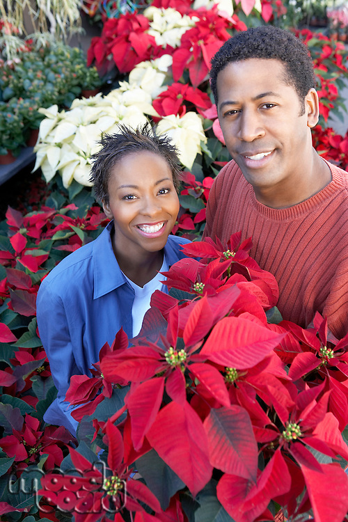 Couple Choosing Poinsettias at a Nursery