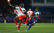 Fraiser Campbell putting his defender under pressure during the Capital One Cup match between Crystal Palace and Charlton Athletic at Selhurst Park, London, England on 23 September 2015. Photo by Michael Hulf.