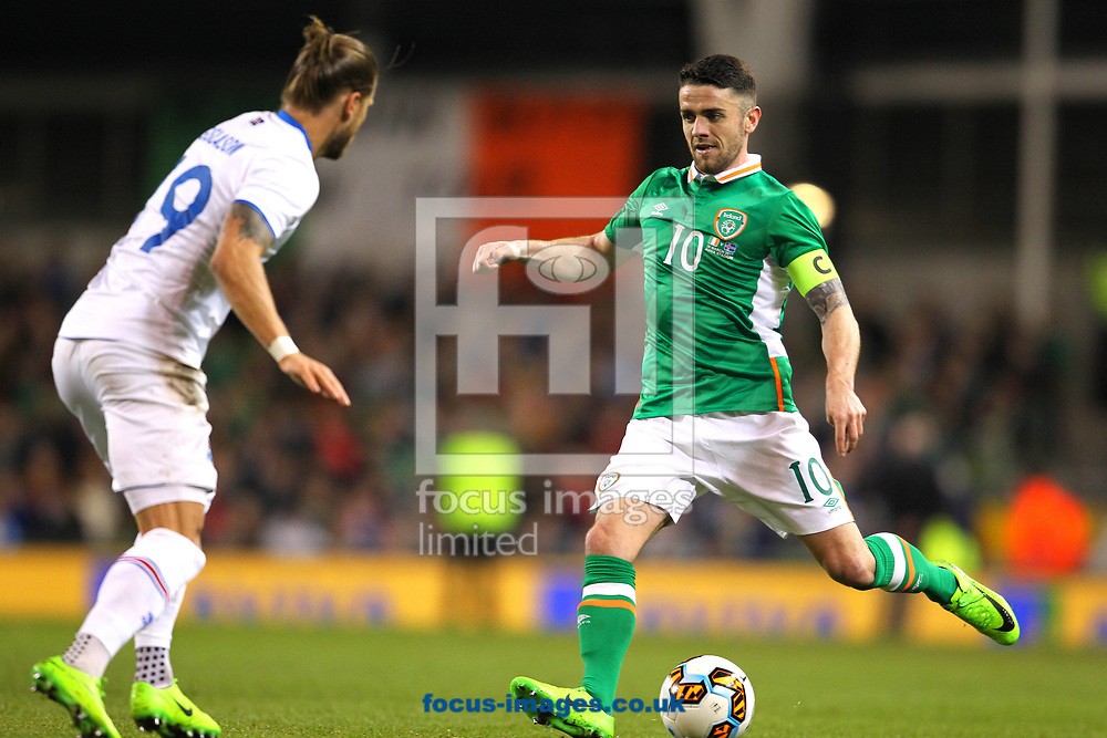 Robbie Brady of Republic of Ireland and Rurik Gislason of Iceland during the International Friendly match at the Aviva Stadium, Dublin<br /> Picture by Yannis Halas/Focus Images Ltd +353 8725 82019<br /> 28/03/2017